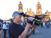 The author framing shots on a Sony HVR-Z1U, with the camera away from the body, on a shoot in Mexico City.